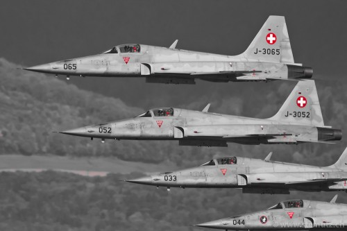 Four Swiss Airforce F-5E II Tiger in formation over lake of Neuchatel, by stemutz