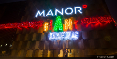 GIANT Christmas Lights 2015, Manor Fribourg with Saxophonist Marc Stucki