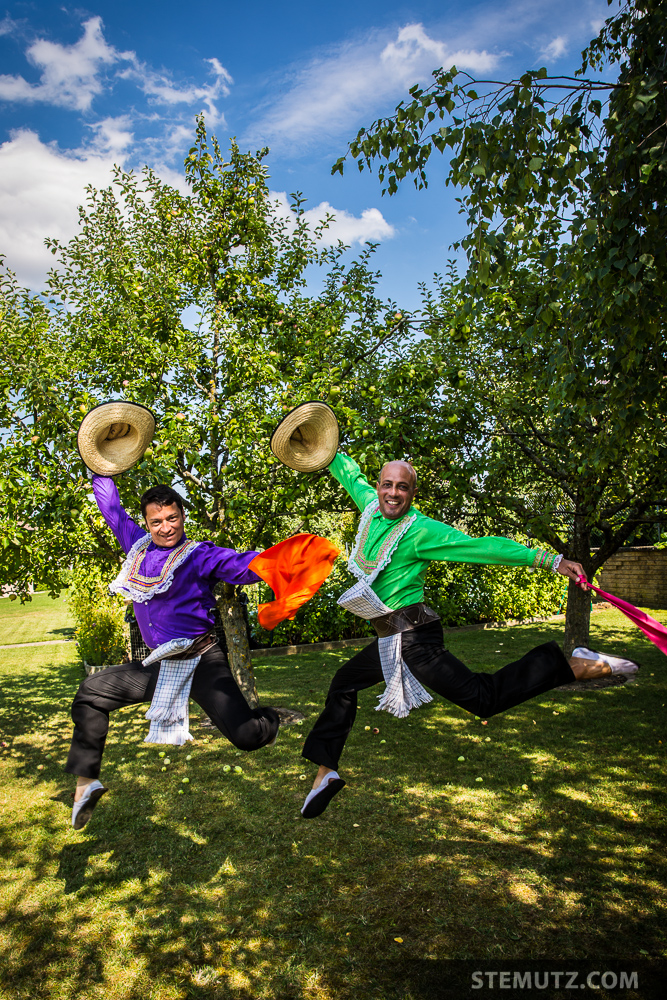 Two Dancers of the Colombian Dance Group Farallones jumping in the Air ...